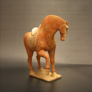 A Tang Dynasty Red Painted Pottery Prancing Horse