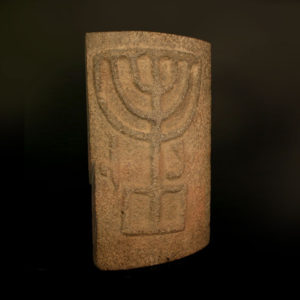 Roman Period Basalt Fragment from a Synagogue Column Depicting a Menorah