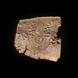 Fragment of a Roman Period Lead Sarcophagus Depicting a Menorah