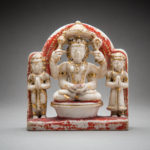 Polychromed Stone Sculpture of a Hindu Deity with Two Attendants