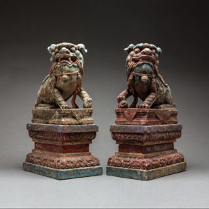 Pair of Polychromed Stone Fu Dogs