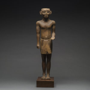 New Kingdom Wooden Sculpture of a Standing Man