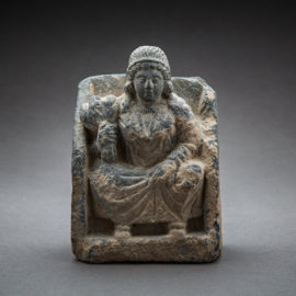 Gandhara schist relief of a seated female figure