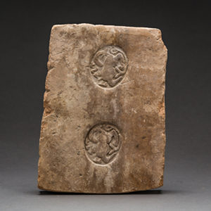 Terracotta Panel with Two Stamped Ibex Roundels and Inscription 1